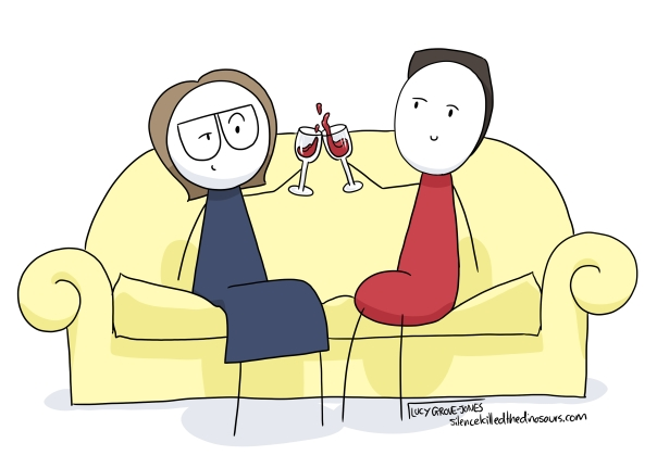 Me and my partner sitting on the couch drinking wine.