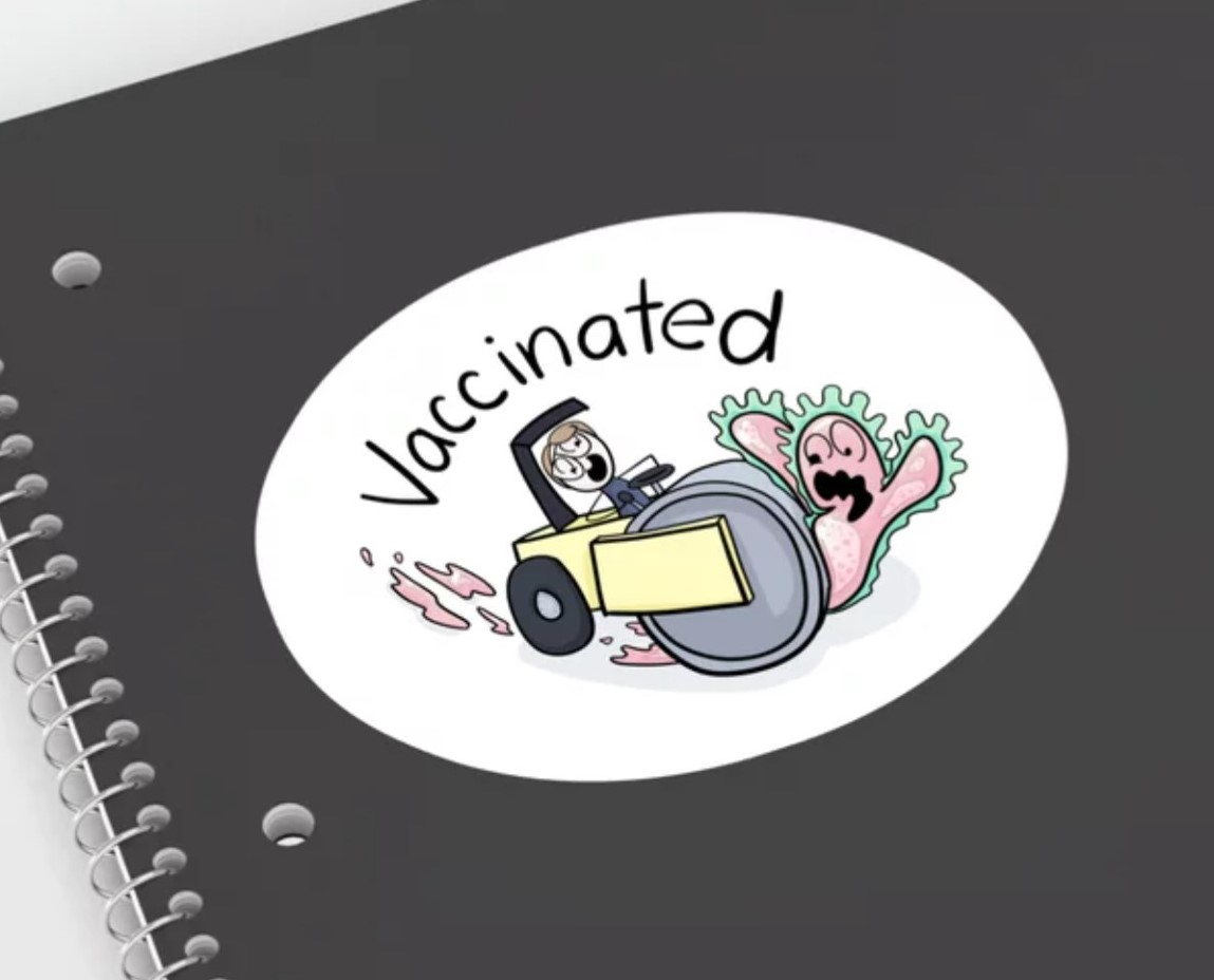 """Sticker of me driving a steamroller over a personified covid virus under the heading """"Vaccinated"""""""